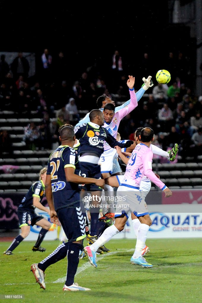 Reims' Togolese goalkeeper Kossi Agassa (Up, back) jumps to stop the ball during the French L1 football match Evian (ETGFC) vs Reims (SR) on March 30, 2013 at the Parc des sports city stadium in Annecy, eastern France.