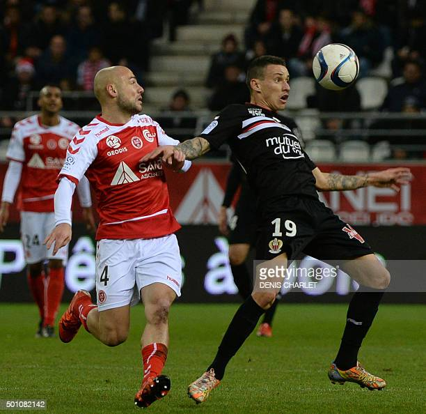 Reims's French midfielder Jaba Kankava vies with Nice's Brazilian midfielder Wallyson Mallmann during the French L1 football match between Reims and...