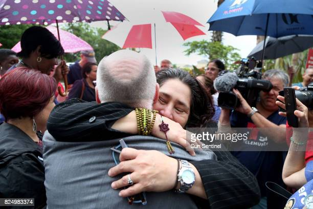 Reina Gomez an undocumented woman from Honduras battling a rare form of leukemia hugs Father Frank Corbishley of St Bede Episcopal Chapel in Coral...