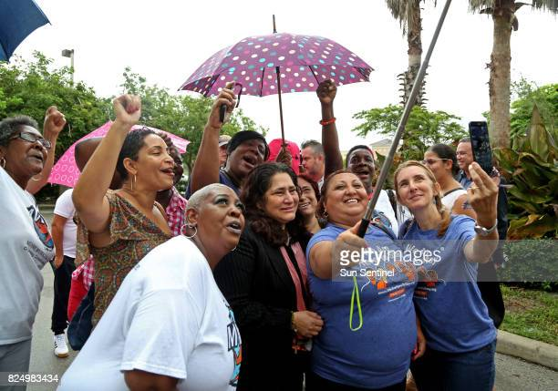 Reina Gomez center black jacket an undocumented Honduran woman battling a rare form of leukemia celebrates with her supporters after leaving her...