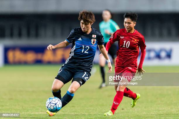 Reina Nagashima of Japan fights for the ball with Kanyanat Chetthabutr of Thailand during their AFC U19 Women'u2019s Championship 2017 Group Stage B...