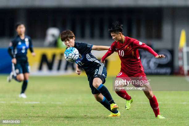 Reina Nagashima of Japan fights for the ball with Tuyet Ngan of Vietnam during their AFC U19 Women'u2019s Championship 2017 Group Stage B match...