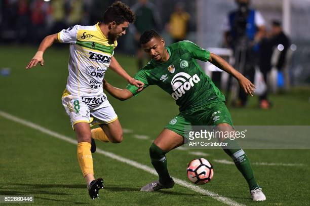 Reinaldo of Brazil's Chapecoense is marked by Jose Rivero of Argentina's Defensa y Justicia during their Copa Sudamericana football match held at the...