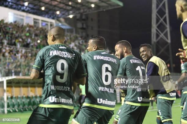 Reinaldo of Chapecoense celebrates dancing after scoring during a match between Chapecoense and Nacional Uruguai as part of Copa Bridgestone...