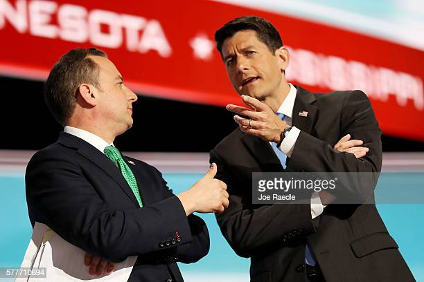 Reince Priebus chairman of the Republican National Committee and Speaker of the House Paul Ryan talk on stage after roll call on the second day of...
