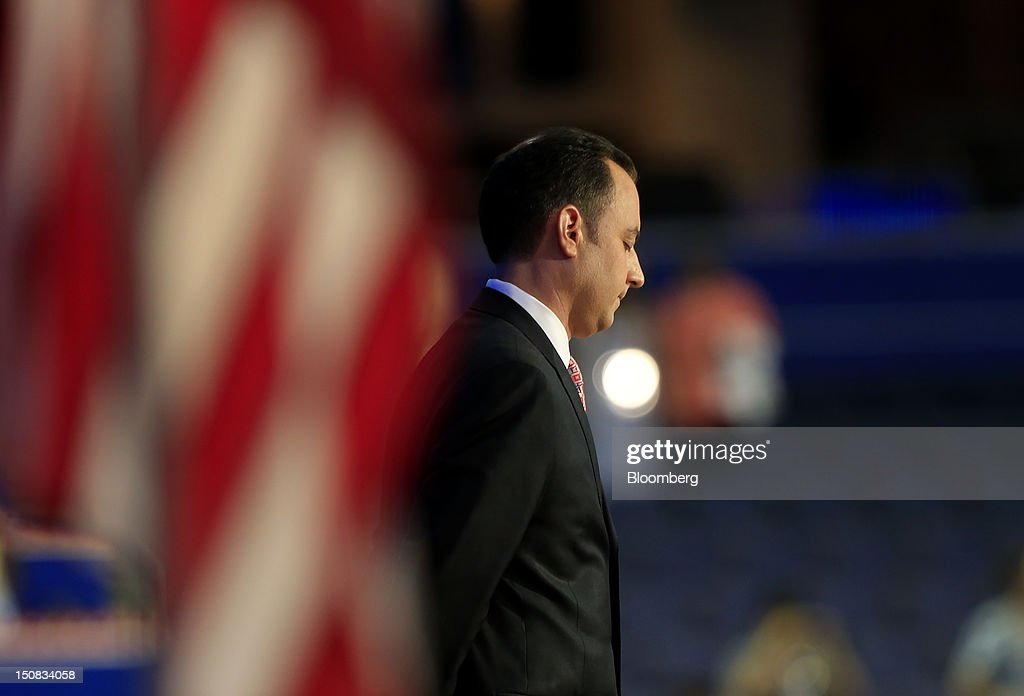 <a gi-track='captionPersonalityLinkClicked' href=/galleries/search?phrase=Reince+Priebus&family=editorial&specificpeople=7419119 ng-click='$event.stopPropagation()'>Reince Priebus</a>, chairman of the Republican National Committee, listens while Reverend Dr. Russell Levenson, unseen, speaks before banging the gavel at the Republican National Convention (RNC) in Tampa, Florida, U.S., on Monday, Aug. 27, 2012. The first day of the RNC is formally convening on Aug. 27 and then immediately recessing until Aug. 28 due to Tropical Storm Isaac. Photographer: Andrew Harrer/Bloomberg via Getty Images