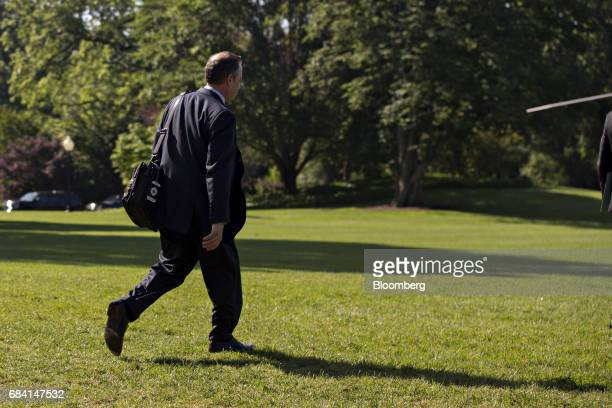 Reince Priebus White House chief of staff walks towards Marine One on the South Lawn of the White House in Washington DC US on Wednesday May 17 2017...