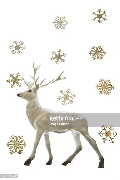 Reindeer figurine and snowflakes
