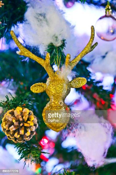 Reindeer head hanging in the Christmas tree
