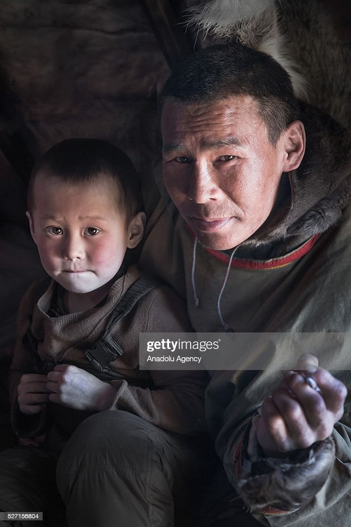 A reindeer herder and his son pose for a photograph at Nomad camp, 150 km from the town of Salekhard, Yamalo-Nenets Autonomous Okrug in Russia on May 2, 2016.