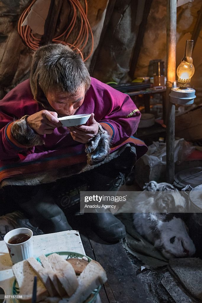 A reindeer herder eats his meal at Nomad camp, 150 km from the town of Salekhard, Yamalo-Nenets Autonomous Okrug in Russia on May 2, 2016.