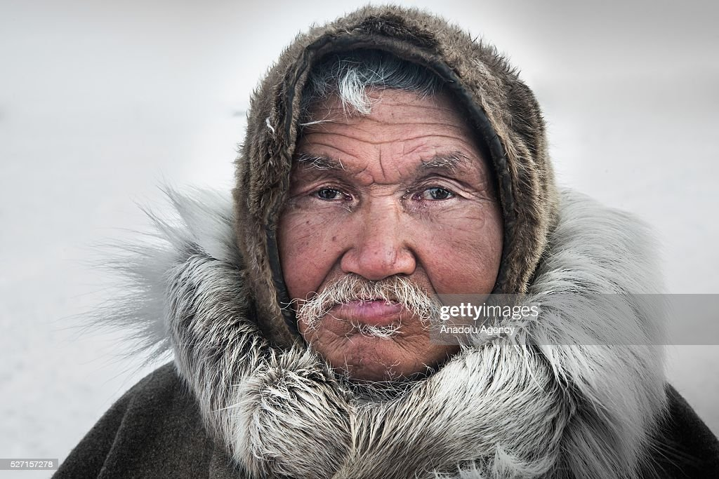 A reindeer herder looks on at a nomad camp at 150 km from the town of Salekhard, Yamalo-Nenets Autonomous Okrug in Russia on May 2, 2016.