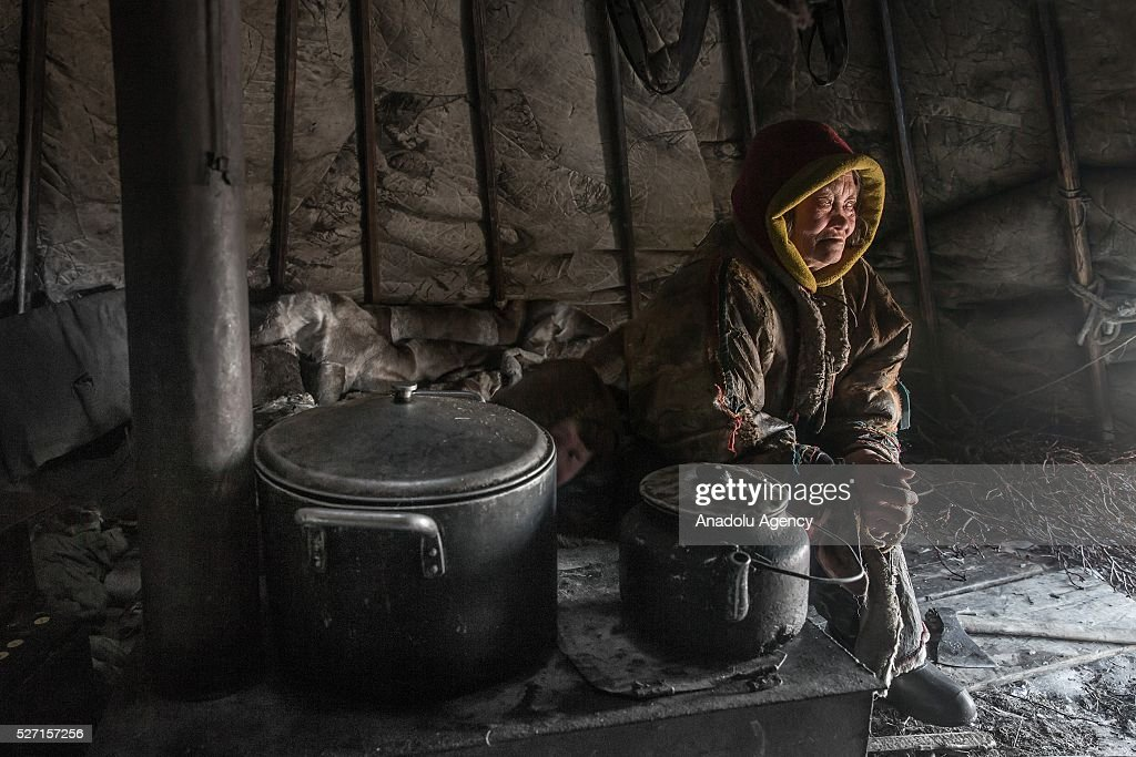 A reindeer herder women is seen in her shelter at 150 km from the town of Salekhard, Yamalo-Nenets Autonomous Okrug in Russia on May 2, 2016.