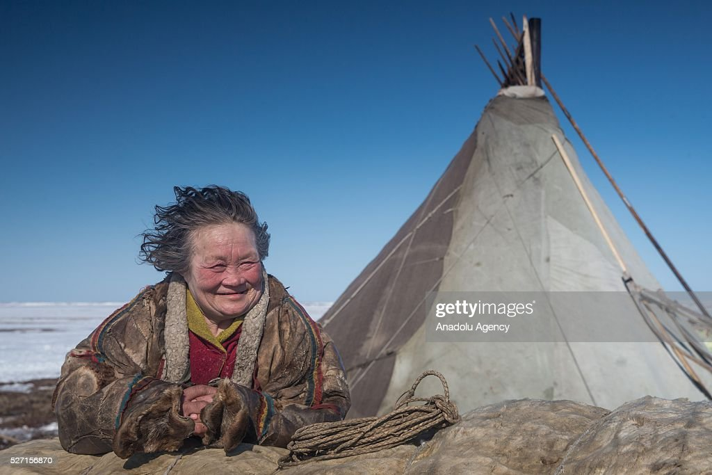 A reindeer herder women looks on at a nomad camp at 150 km from the town of Salekhard, Yamalo-Nenets Autonomous Okrug in Russia on May 2, 2016.