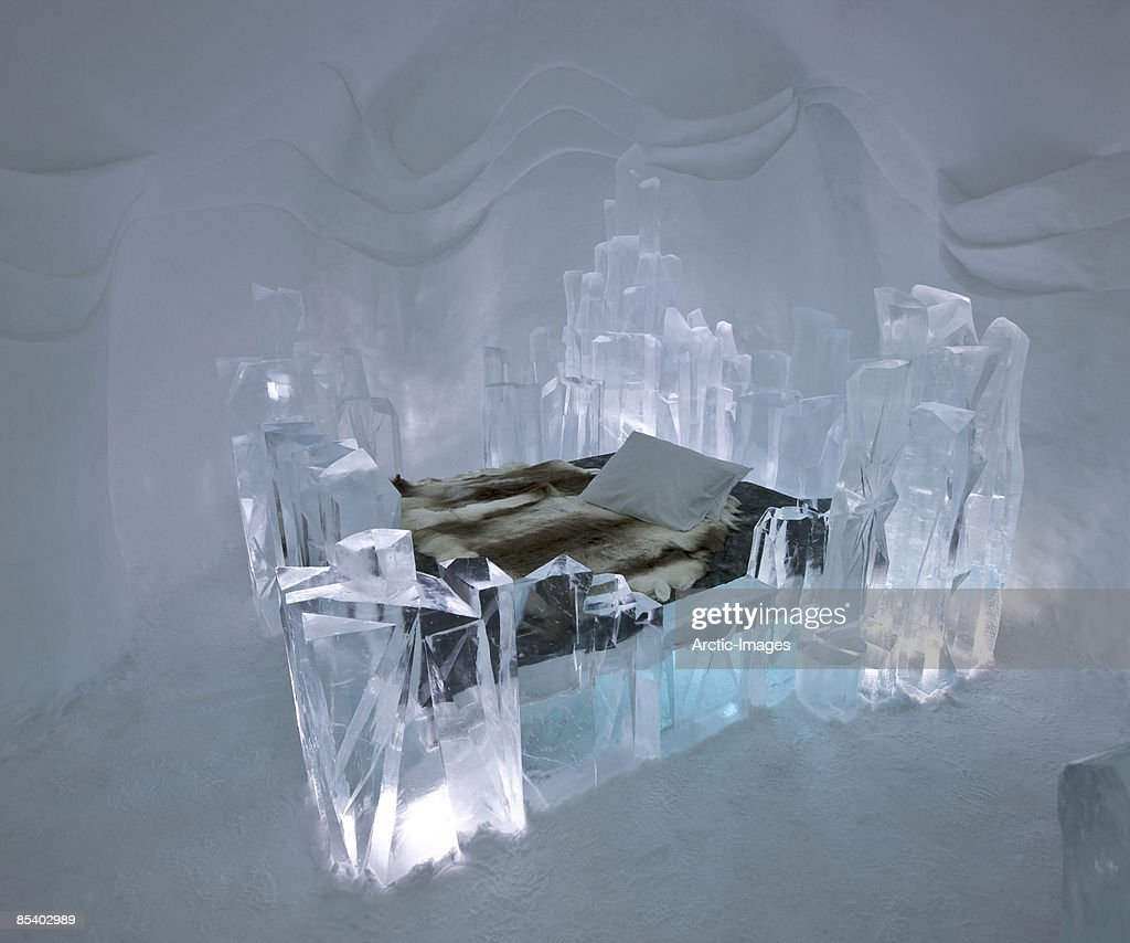 Reindeer hides on bed in Ice Hotel : Stock Photo