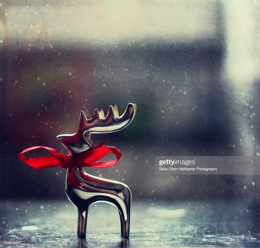 Reindeer silver red bow : Stock Photo