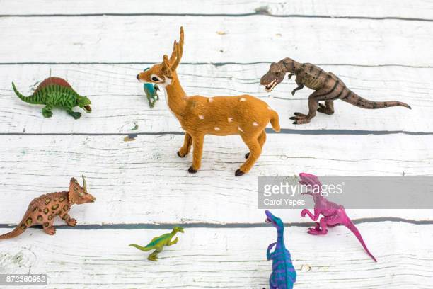reindeer surrounded by dinosaurs.Bullying concept