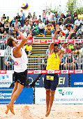 Reinder Nemmerdor of Netherlands and Ricardo Santos of Brazil compete in the gold medal match at Jose Correa Gymnasium during day six of the FIVB Sao...