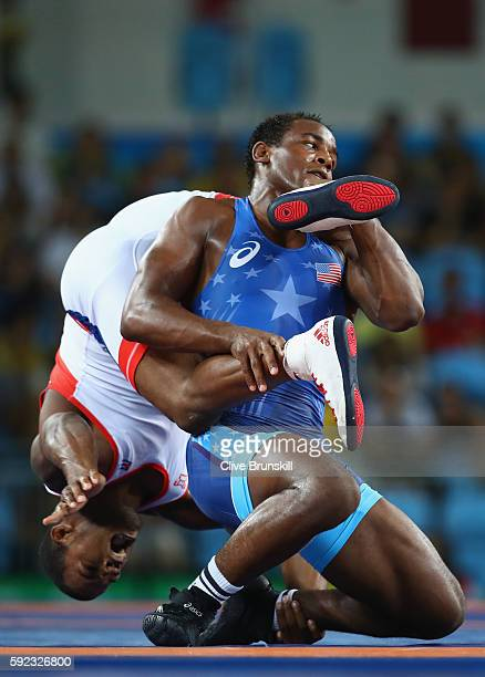 Reineris Salas Perez of Cuba and J'den Michael Tbory Cox of the United States compete during the Men's Freestyle 86kg Bronze Medal bout on Day 15 of...