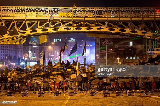 A reinforced makeshift barricade with antipersonnel obstacles and barbed wire on Instytutska street closes the access to Maidan Square on December 14...