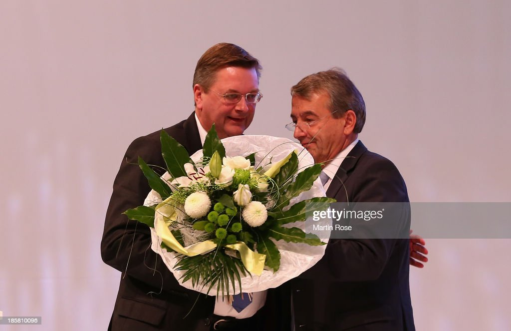 Reinhard Grindel is congratulated by DFB president <a gi-track='captionPersonalityLinkClicked' href=/galleries/search?phrase=Wolfgang+Niersbach&family=editorial&specificpeople=555796 ng-click='$event.stopPropagation()'>Wolfgang Niersbach</a> after his election as the new DFB treasurer during the DFB Bundestag Day 2 at NCC Nuremberg on October 25, 2013 in Nuremberg, Germany.