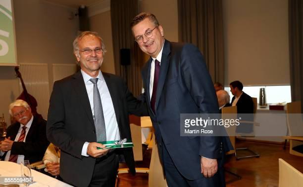 Reinhard Grindel of the DFB hands over a present to Kurt Gaertner during 15th Anniversary Of DFBnet on September 29 2017 in Barsinghausen Germany
