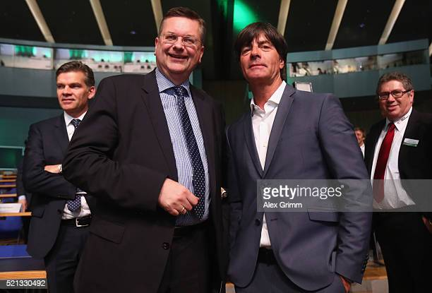 Reinhard Grindel poses with Joachim Loew after being elected new DFB President during the extraordinary DFB Bundestag at Congress Center Messe...