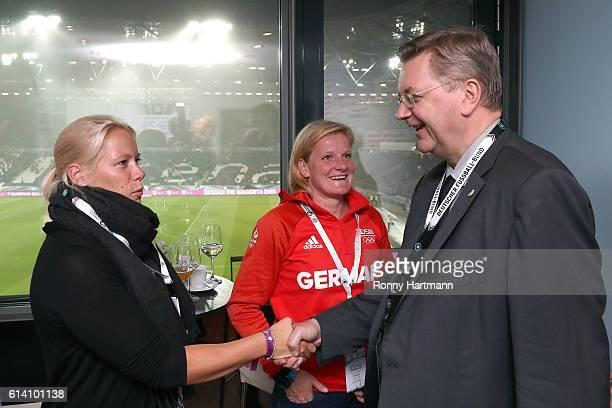 Reinhard Grindel president of Deutscher Fussball Bund DFB chats with Annekatrin Thiele and Tina Dietze prior to the FIFA 2018 World Cup Qualifier...
