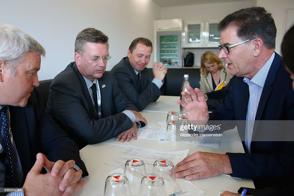 <a gi-track='captionPersonalityLinkClicked' href=/galleries/search?phrase=Reinhard+Grindel&family=editorial&specificpeople=8750586 ng-click='$event.stopPropagation()'>Reinhard Grindel</a> (L), President of the <a gi-track='captionPersonalityLinkClicked' href=/galleries/search?phrase=Reinhard+Grindel&family=editorial&specificpeople=8750586 ng-click='$event.stopPropagation()'>Reinhard Grindel</a>, President of Deutscher Fussball Bund DFB and German Development Minister Gerd Mueller (R) signs a contract for cooperation and partnership in Sports and Development ahead of the international friendly match between Germany and Slovakia at WWK-Arena on May 29, 2016 in Augsburg, Germany.