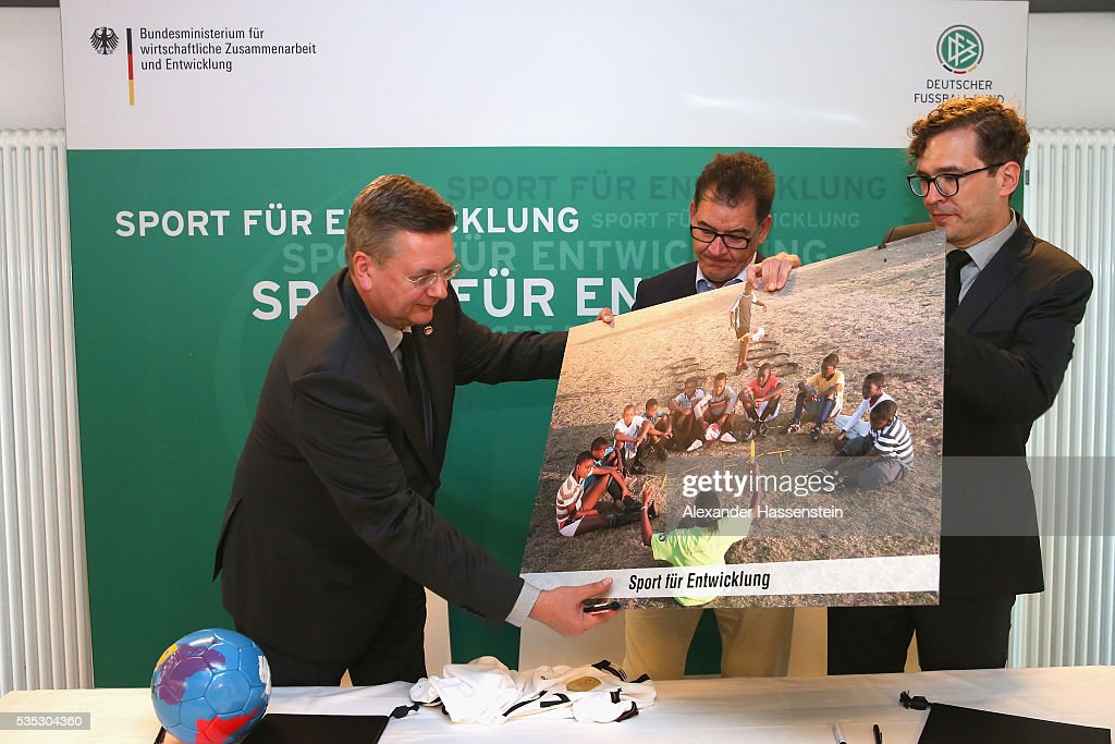 <a gi-track='captionPersonalityLinkClicked' href=/galleries/search?phrase=Reinhard+Grindel&family=editorial&specificpeople=8750586 ng-click='$event.stopPropagation()'>Reinhard Grindel</a> (L), President of the <a gi-track='captionPersonalityLinkClicked' href=/galleries/search?phrase=Reinhard+Grindel&family=editorial&specificpeople=8750586 ng-click='$event.stopPropagation()'>Reinhard Grindel</a>, President of Deutscher Fussball Bund DFB and DFB Secretary General Friedrich Curtius (R) sign a contract for cooperation and partnership in Sports and Development with German Development Minister Gerd Mueller (R) ahead of the international friendly match between Germany and Slovakia at WWK-Arena on May 29, 2016 in Augsburg, Germany.