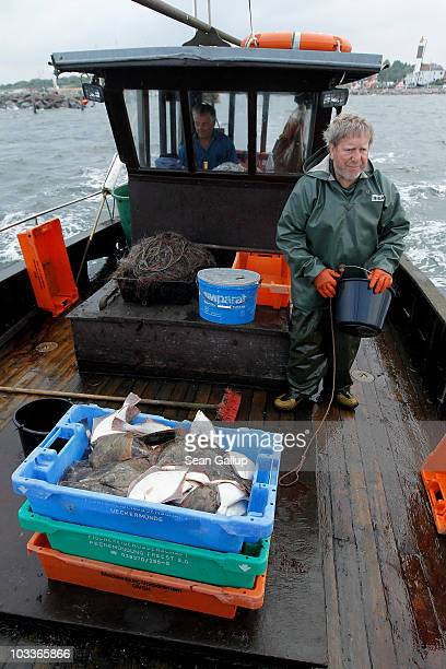 Reinhard Lay a 30year veteran fisherman returns to Timmendorf port with the plaice flounder and cod he and his fishing partner Klaus Raack hauled in...