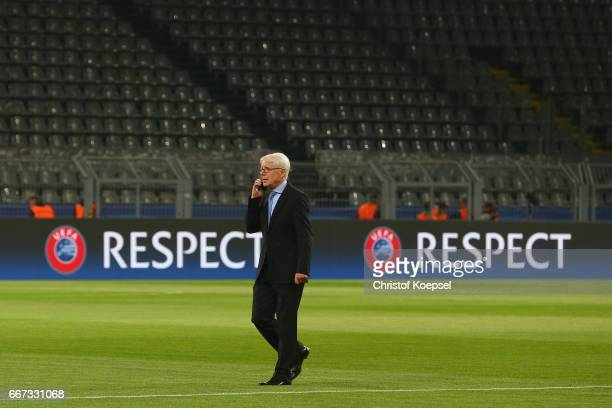 Reinhard Rauball of Dortmund walks off the pitch concerned of the bomb attack to the bus of Dortmund of the UEFA Champions League Quarter Final first...