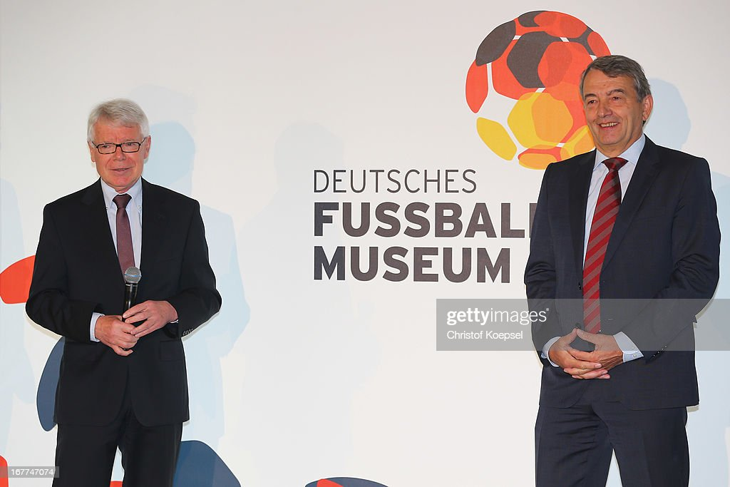 Reinhard Rauball, president of the DF and Wolfgang Niersbach, president of the German Football Association present the official logo of the DFB Football Museum during the DFB Football Museum groundbreaking ceremony at Harenberg City Center on April 29, 2013 in Dortmund, Germany.