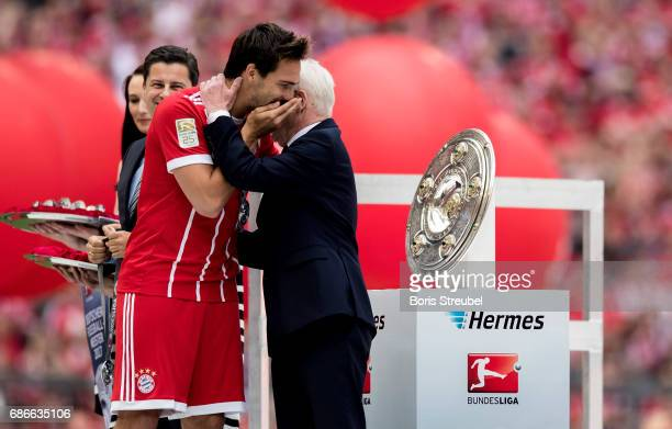 Reinhard Rauball whispers with Mats Hummels of FC Bayern Muenchen in celebration of the 67th German Championship title following the Bundesliga match...