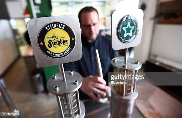Reinhold Barta founder and managing brewmaster at Brauhaus Gusswerk GmbH brewery partowned by PDP Holding GmbH pours a beer in Salzburg Austria on...