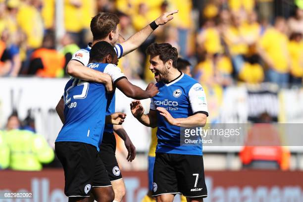 Reinhold Yabo of Bielefeld and his team mates Fabian Klos and Michael Goerlitz celebrates after scoring their third goal with his team mates during...