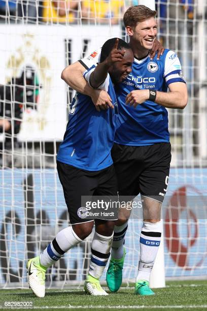 Reinhold Yabo of Bielefeld and his team mates Fabian Klos celebrates after scoring their third goal with his team mates during the Second Bundesliga...