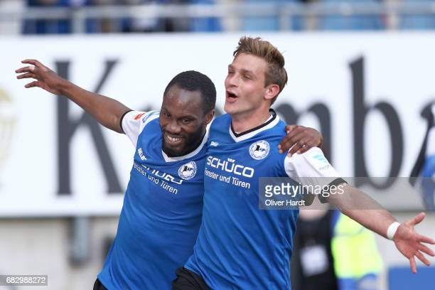 Reinhold Yabo of Bielefeld celebrates after scoring their second goal with his team mates Tom Schuetz during the Second Bundesliga match between DSC...