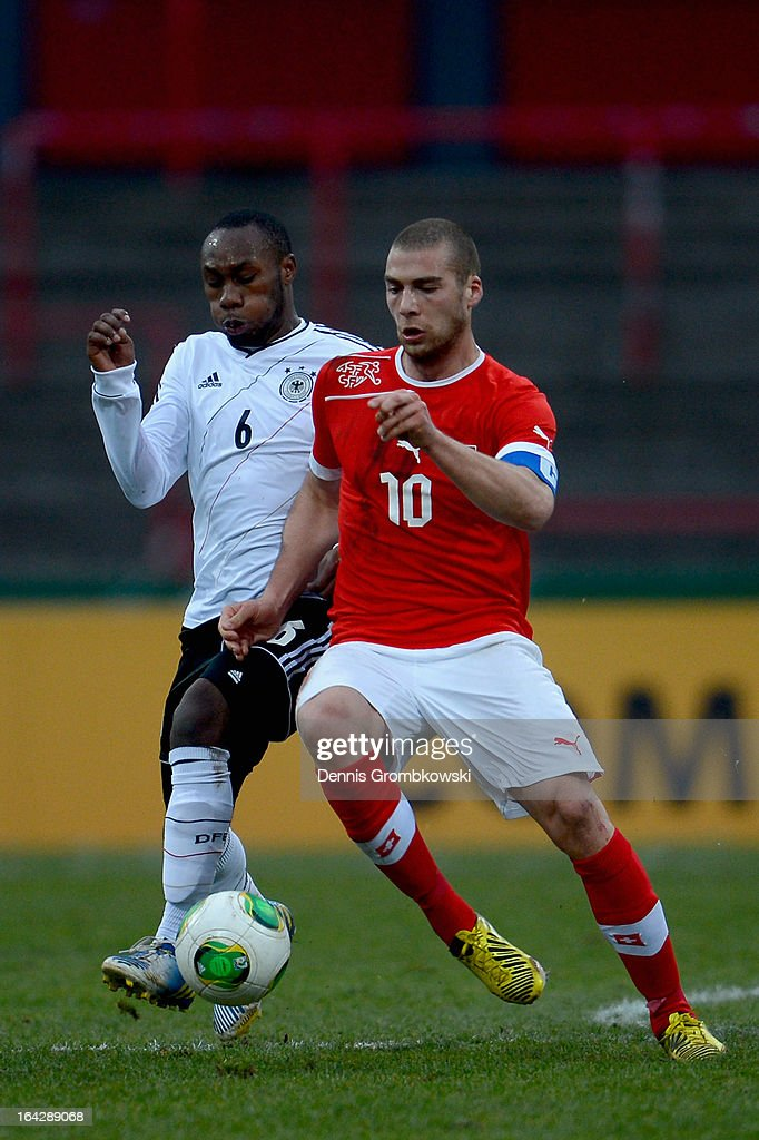 Reinhold Yabo of Germany and Pajtim Kasami of Switzerland battle for the ball during the International Friendly match between U20 Germany and U20 Switzerland on March 22, 2013 in Cologne, Germany.