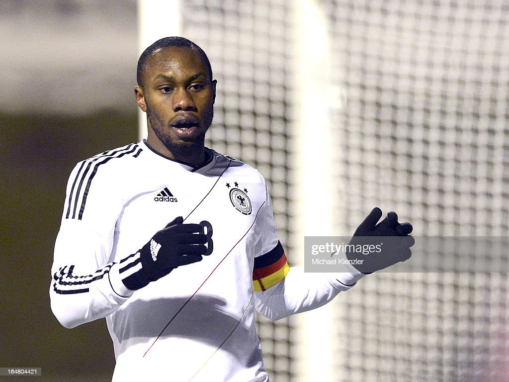 <a gi-track='captionPersonalityLinkClicked' href=/galleries/search?phrase=Reinhold+Yabo&family=editorial&specificpeople=4251446 ng-click='$event.stopPropagation()'>Reinhold Yabo</a> of Germany reacts during the international friendly match between U20 Switzerland and U20 Germany at Eps Stadium on March 26, 2013 in Baden, Switzerland