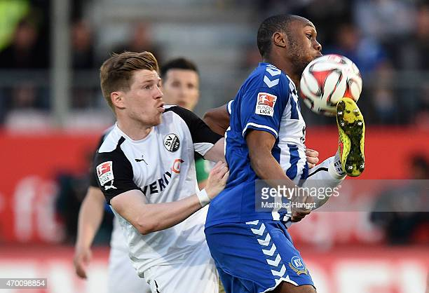 Reinhold Yabo of Karlsruhe is challenged by Denis Linsmayer of Sandhausen during the Second Bundesliga match between SV Sandhausen and Karlsruher SC...