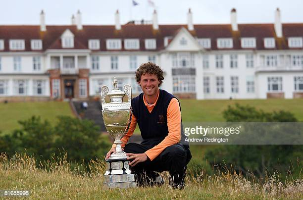 Reinier Saxton of The Netherlands poses with the trophy after his victory in The Final of The Amateur Championship on the Ailsa Course at Turnberry...