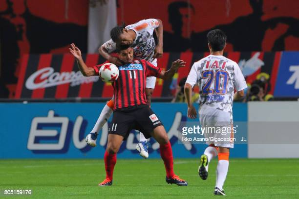 Reis of Consadole Sapporo and Kanu of Shimizu SPulse compete for the ball during the JLeague J1 match between Consadole Sapporo and Shimizu SPulse at...