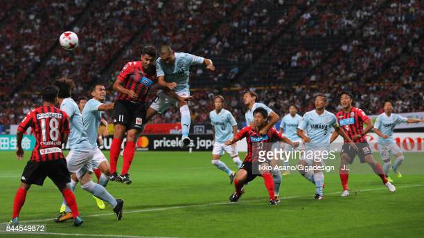Reis of Consadole Sapporo and Kengo Kawamata of Jubilo Iwata compete for the ball during the JLeague J1 match between Consadole Sapporo and Jubilo...