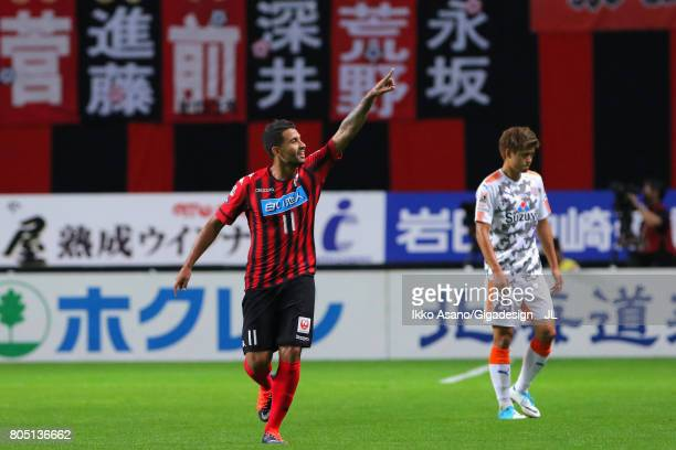 Reis of Consadole Sapporo celebrates scoring the opening goal during the JLeague J1 match between Consadole Sapporo and Shimizu SPulse at Sappaoro...