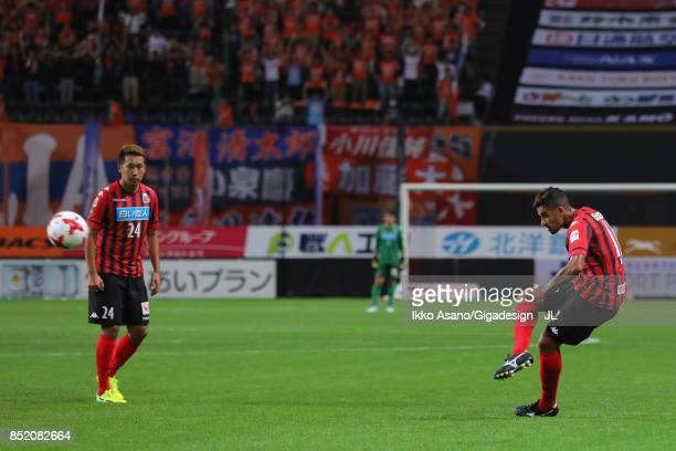 Reis of Consadole Sapporo scores his side's second goal from a free kick during the JLeague J1 match between Consadole Sapporo and Albirex Niigata at...