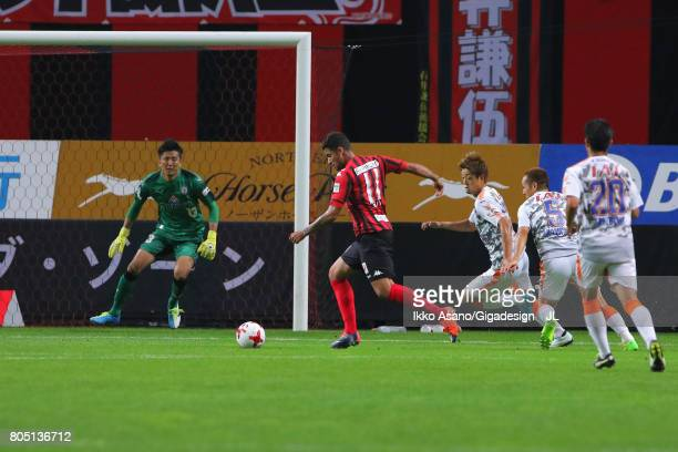 Reis of Consadole Sapporo scores the opening goal during the JLeague J1 match between Consadole Sapporo and Shimizu SPulse at Sappaoro Dome on July 1...
