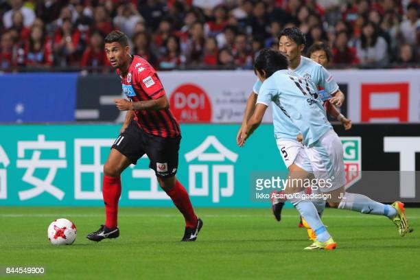 Reis of Consadole Sapporo takes on Shunsuke Nakamura of Jubilo Iwata during the JLeague J1 match between Consadole Sapporo and Jubilo Iwata at...