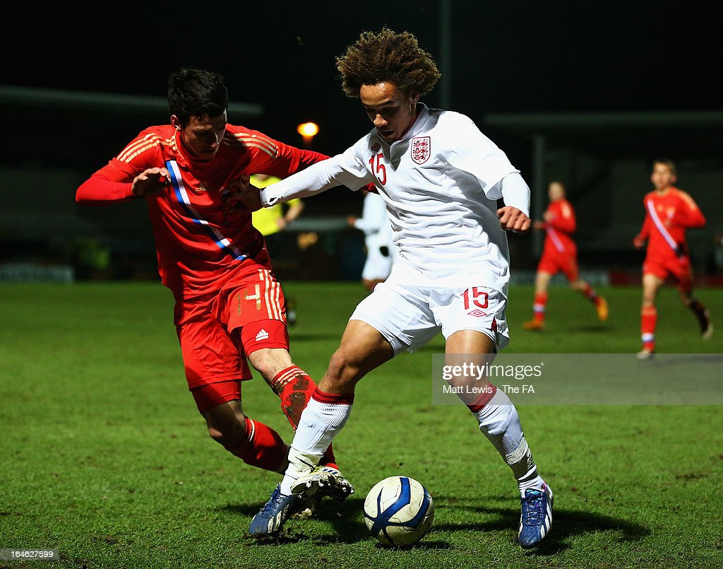 Reise Allassani of England and Nikolaesh Anatolie of Russia challenge for the ball during the UEFA European Under-17 Championship Elite Round match between England and Russia at Pirelli Stadium on March 25, 2013 in Burton-upon-Trent, England.