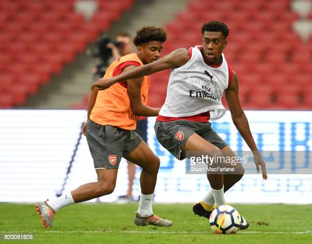 Reiss Nelson and Alex Iwobi of Arsenal during a training session at the Birds Nest stadium on July 21 2017 in Beijing China